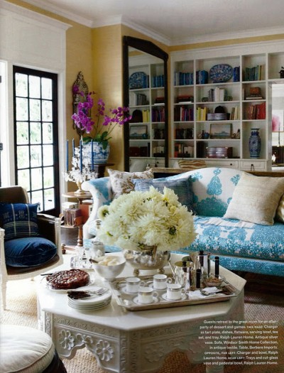house_beautiful_windsor_smith_blue_patterned_sofa_camelback_whtie_ornate_octogan_coffee_table via designmanifest